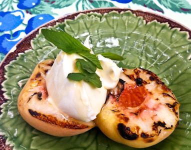Grilled peaches topped with marscapone cheese and a drizzle of honey