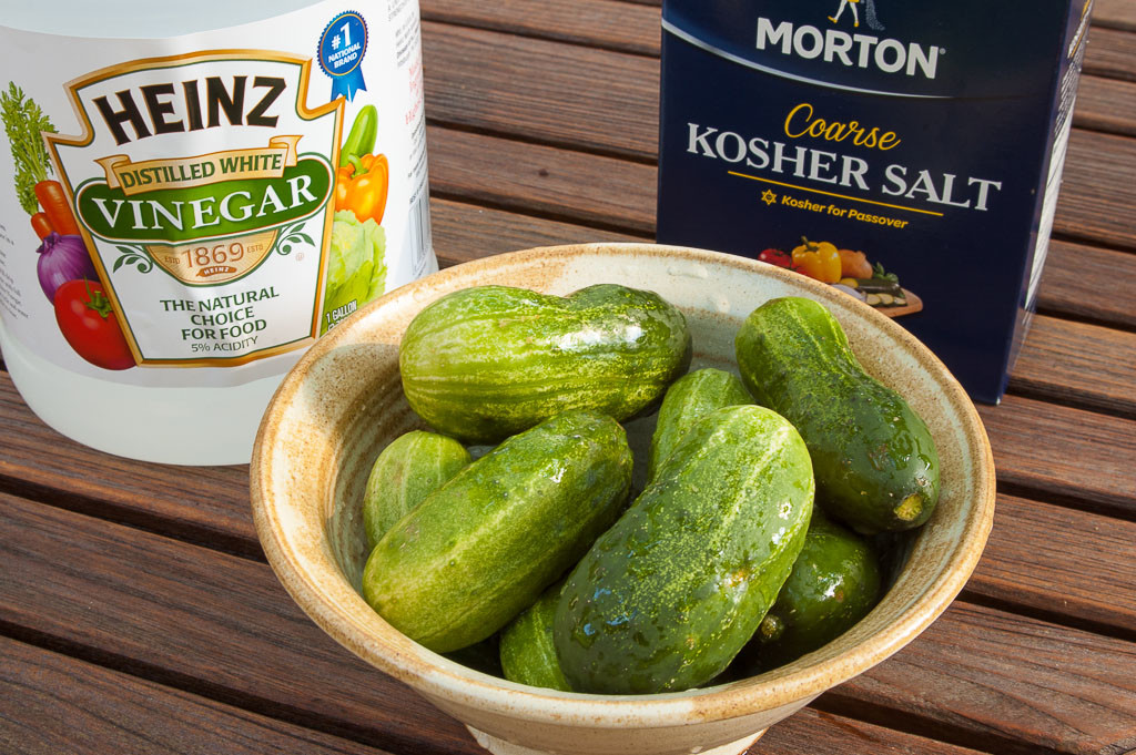 "A bowl of Kirby cucumbers, Heinz vinegar, and Morton's Kosher salt for making quick refrigerator pickles or ""Quickles"""