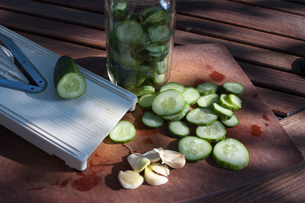 "Sliced cucumbers and crushed garlic for making quick refrigerator pickles or ""Quickles"""